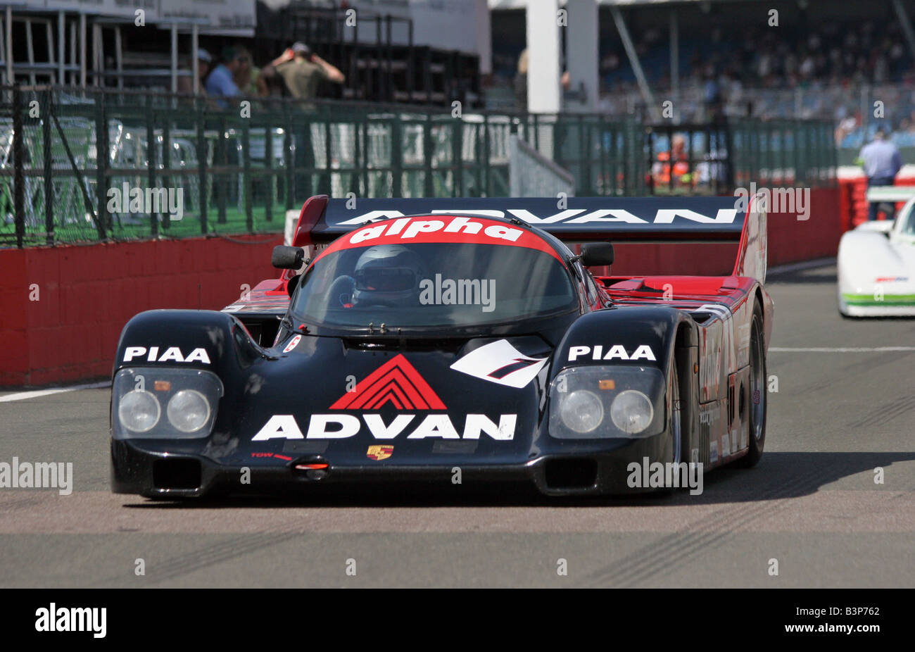 Steven Jones and Roger Green  from UK in No.1 a 1986 Blak/Advan, Porsche 962 coming into the pit lane - Stock Image