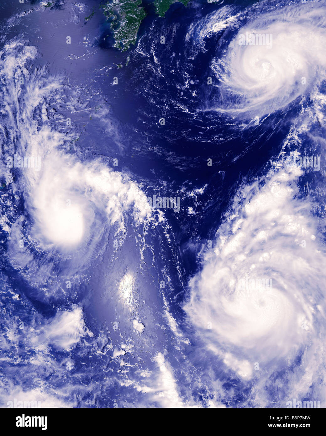 satellite photograph of three tropical storms - Stock Image