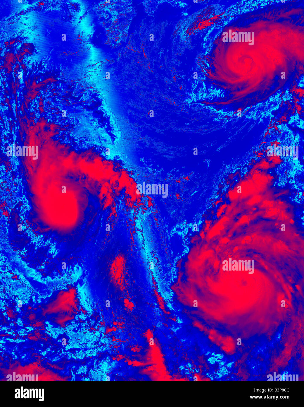 color coded satellite photograph of three tropical storms - Stock Image