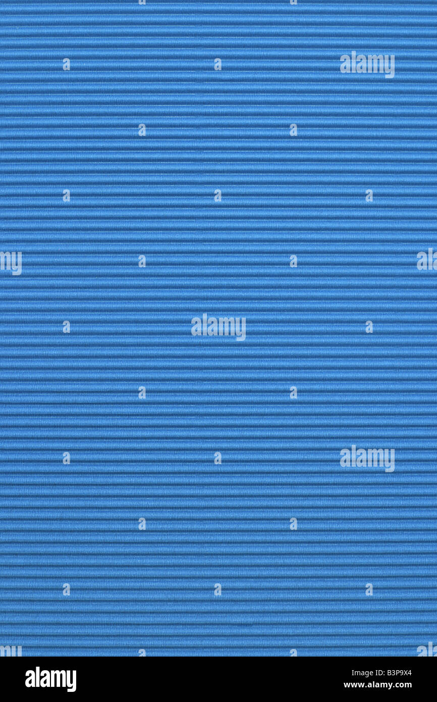 Blue corrugated color paper background - Stock Image