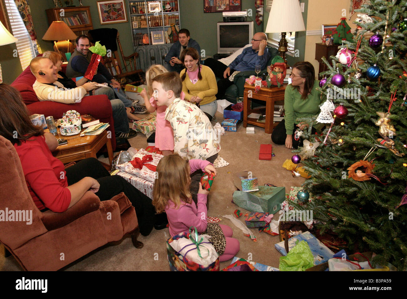 extended family opening presents on christmas morning stock image
