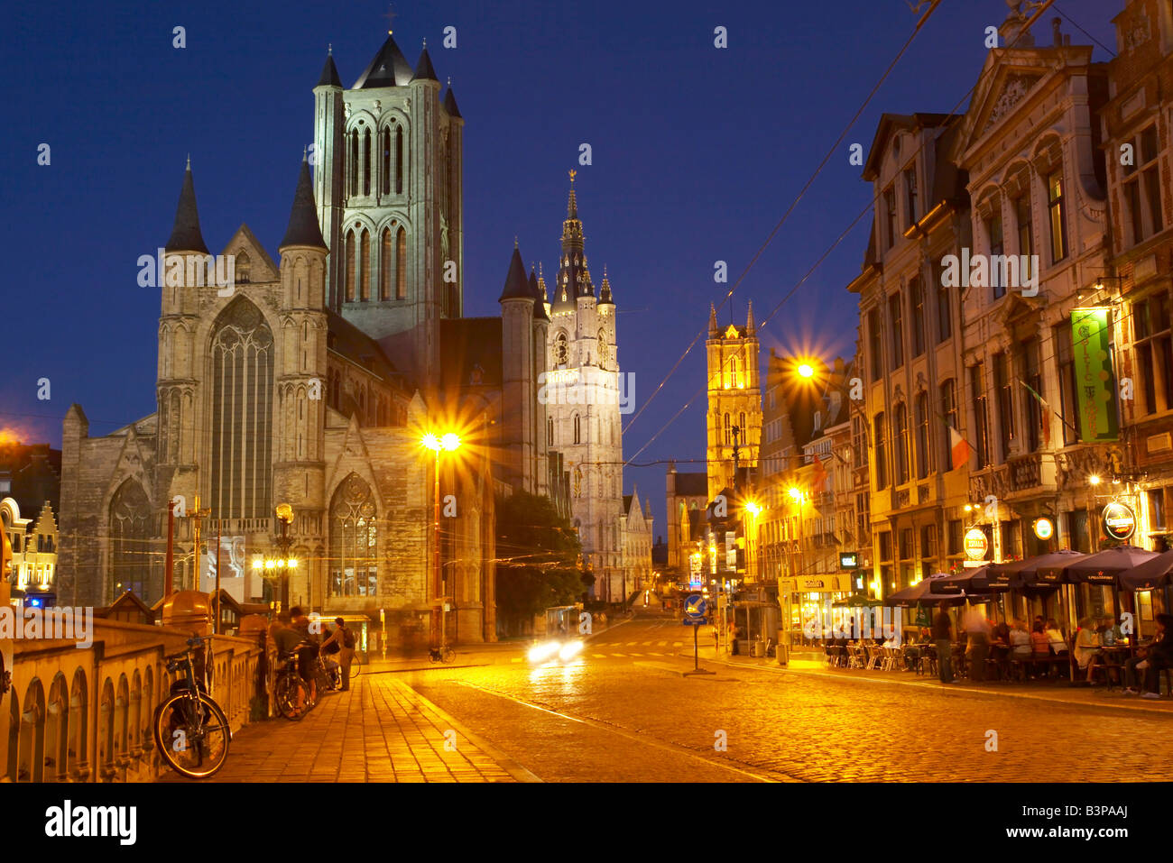 Central Ghent at night, from St Michael's Bridge, showing St Nicolas' church, the Belfry and St Bavo's - Stock Image