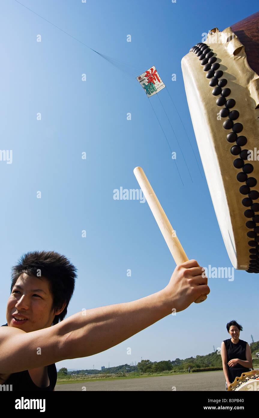 Japan, Kanagawa prefecture, Sagamihara near Tokyo, Taiko drumming group Otako age giant kite flying festival - Stock Image