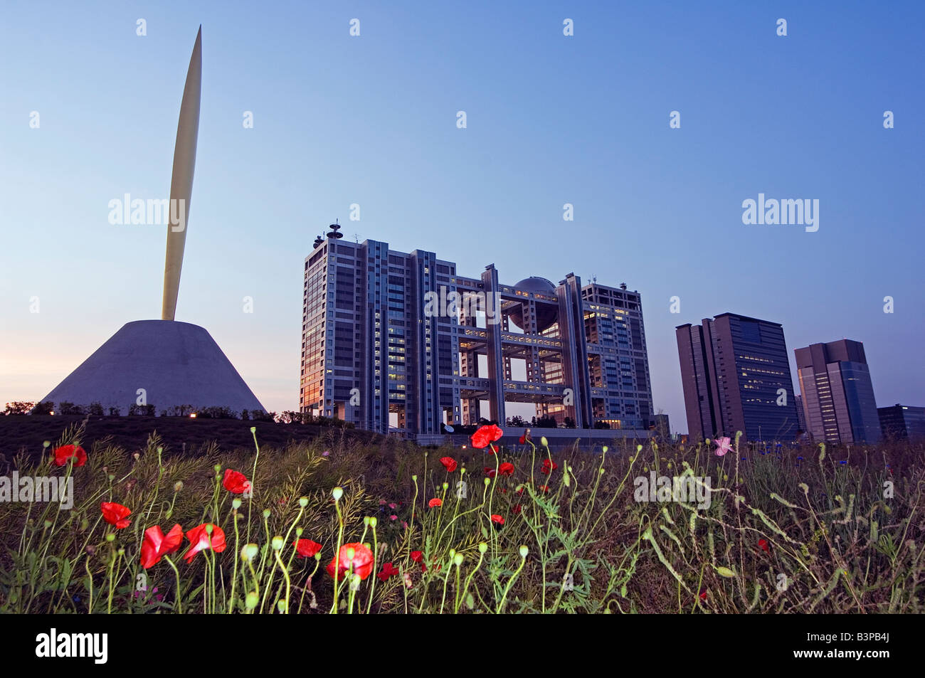 Japan, Tokyo, Odaiba District. The Flame of the Liberty Gold Needle and the Fuji TV Building - Stock Image