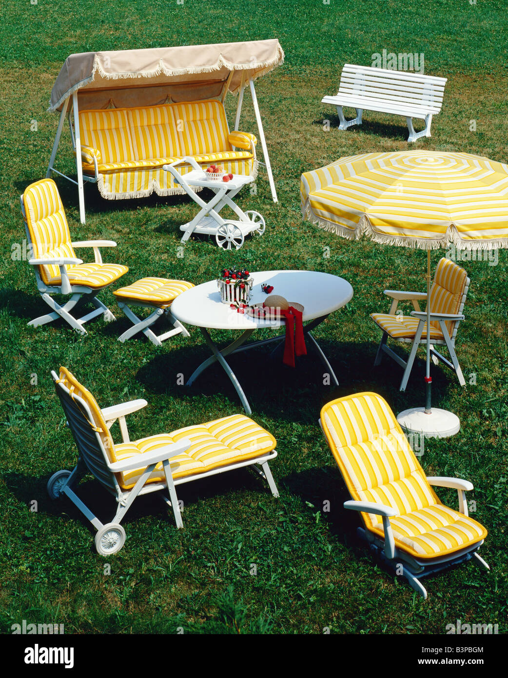 GARDEN FURNITURE CHAIR ARMCHAIRS LAWN SWING AND PARASOL DECORATED WITH YELLOW  STRIPED FABRIC