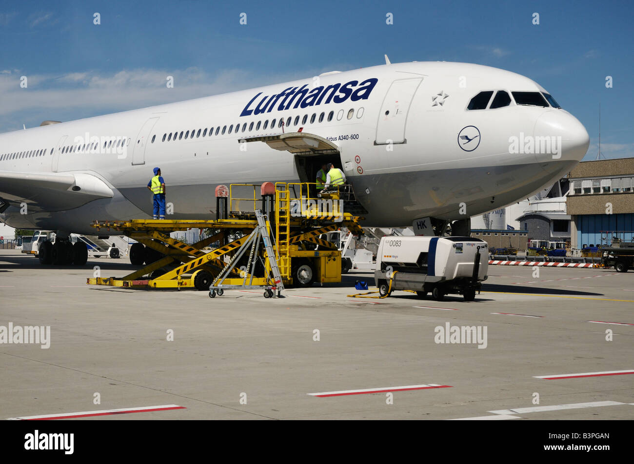 Lufthansa plane being loaded, Frankfurt Airport, Hesse, Germany, Europe - Stock Image