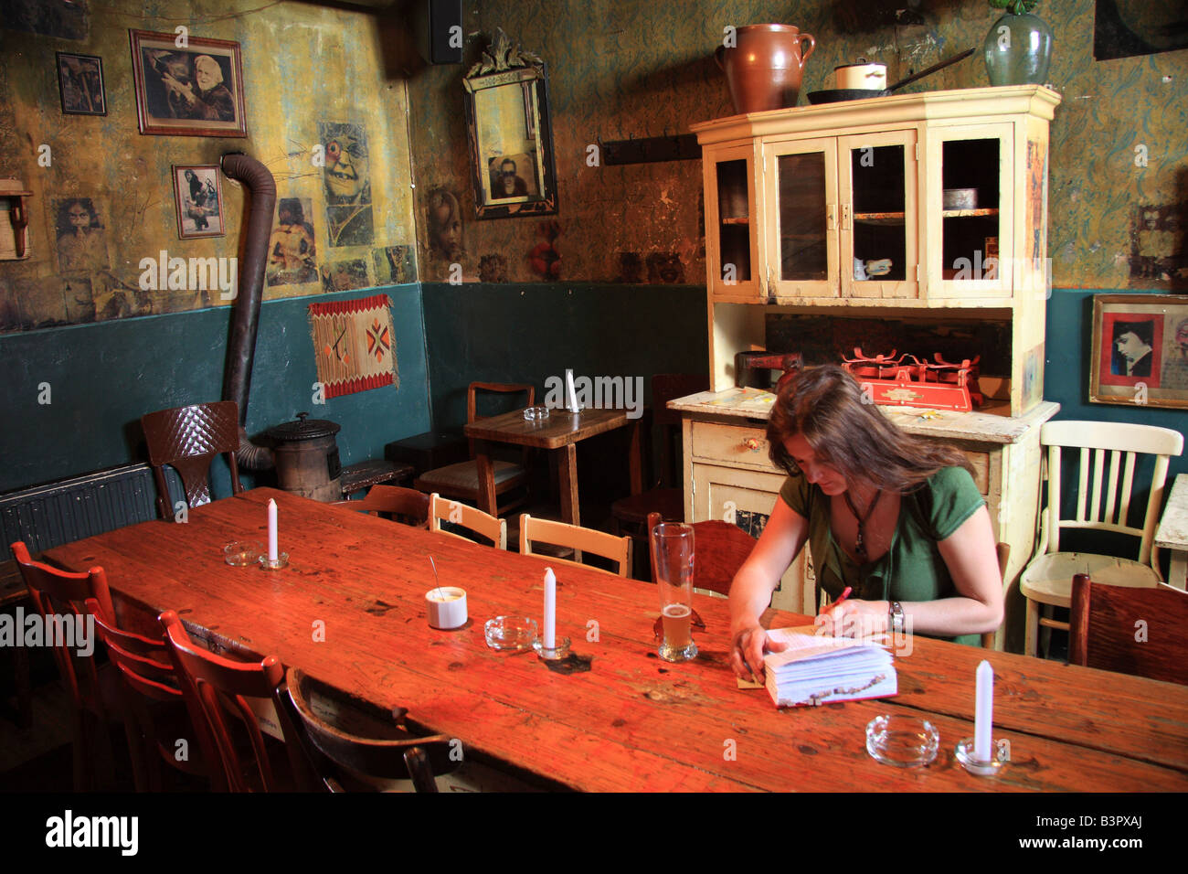 Woman In The Basement Room Of The Flamboyantly Decorated Alchemia Bar In  Kazimierz; The Jewish Quarter Of Krakow, Poland