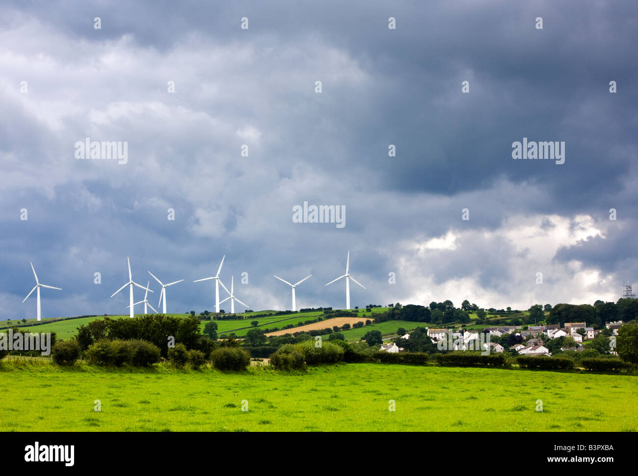 Wind farm next to the small village of Bothel in Cumbria, The Lake District, England, UK - Stock Image