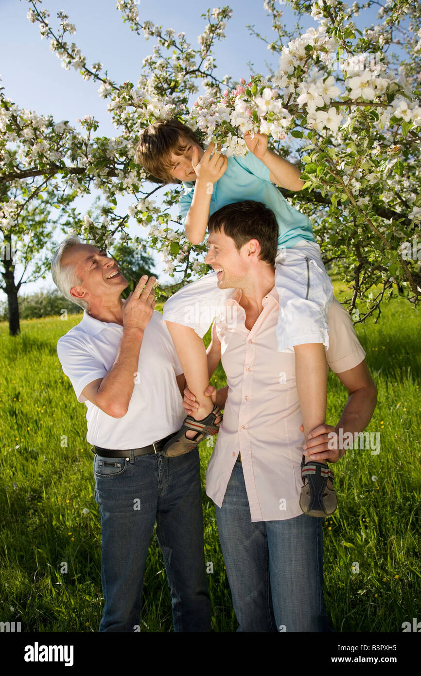 Germany, Baden Wrttemberg, Tbingen, Three generation family,  Boy (11) sitting on father's shoulders, looking - Stock Image