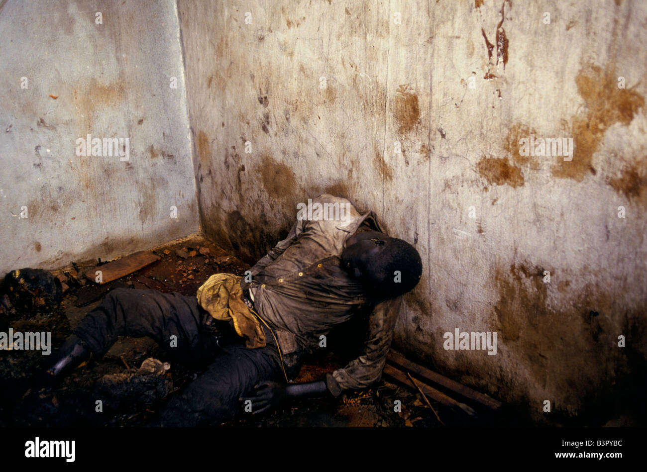 Tutsi school children burned to death in the office of the petrol station in Kibimba on the day after the coup - Stock Image