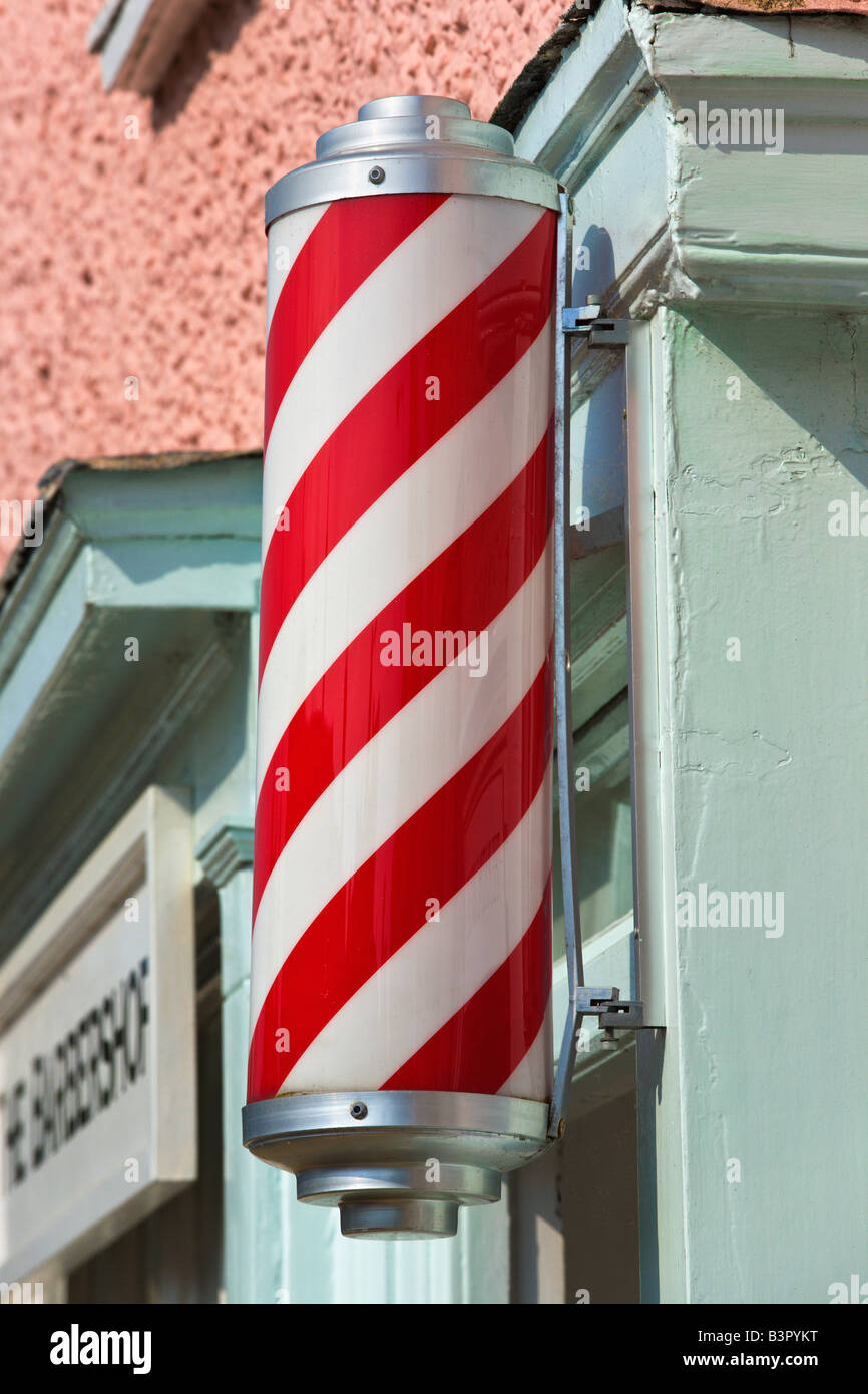 Red and White striped barbers sign, Long Melford, Suffolk, England - Stock Image