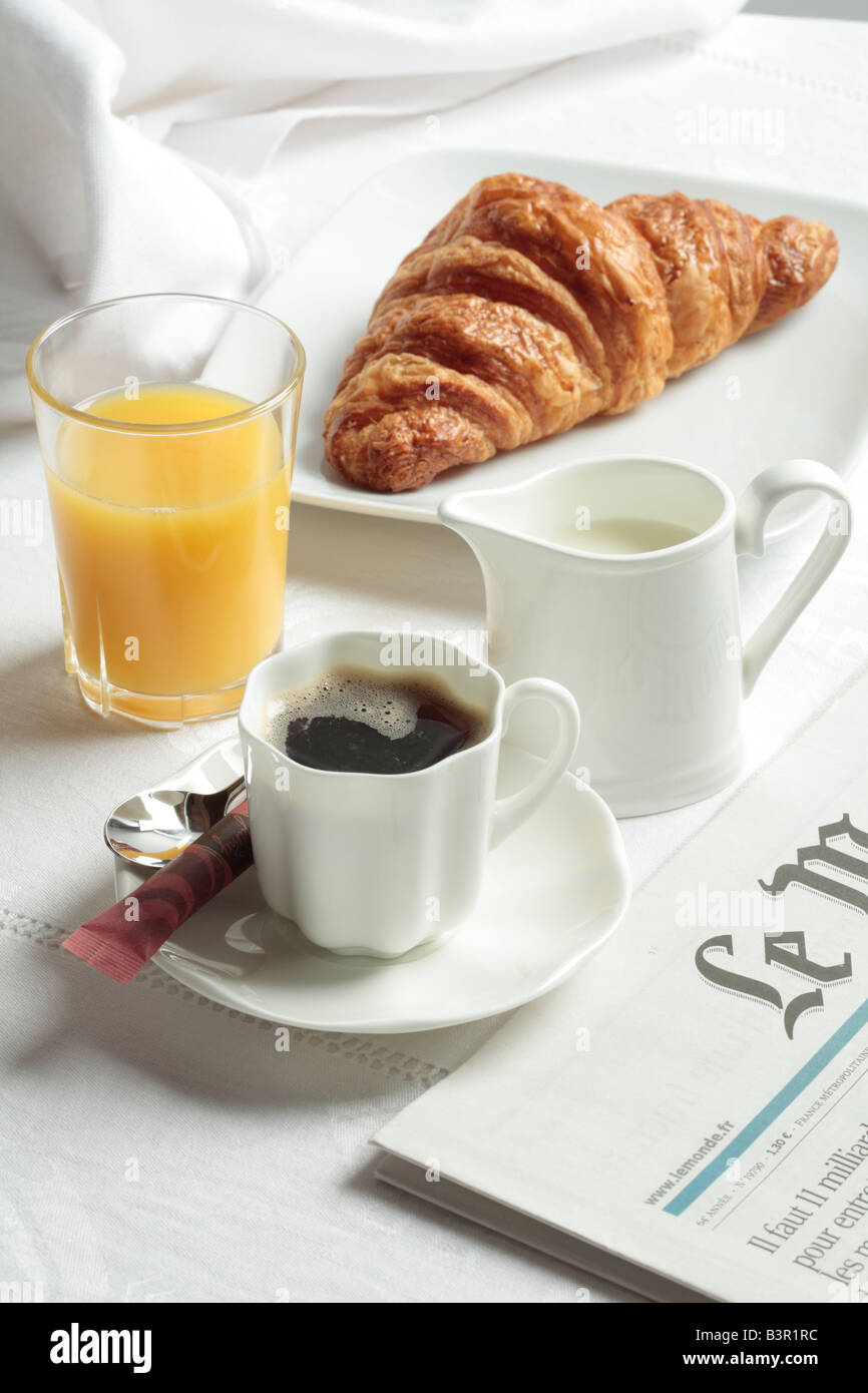 Continental Breakfast with Croissant, Coffee and Orange Juice. - Stock Image
