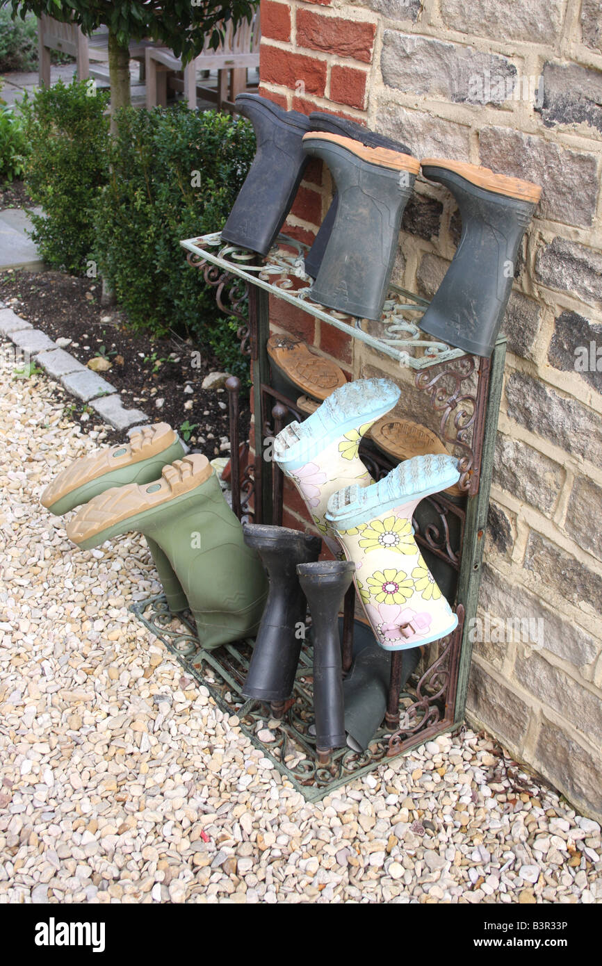 Wellington boots on an outside shoe stand. Stock Photo