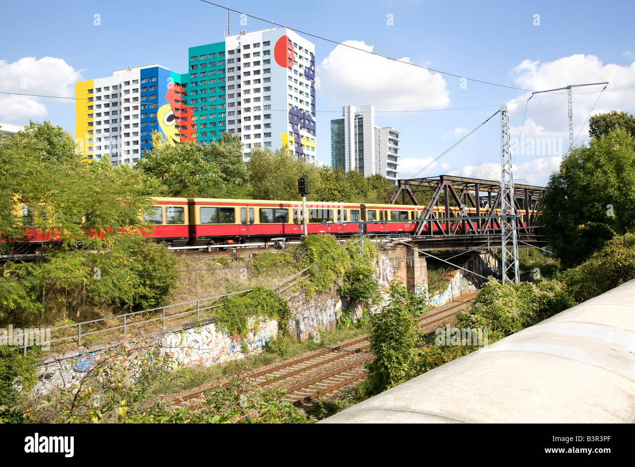 Railroad and tower block in Berlin Germany - Stock Image