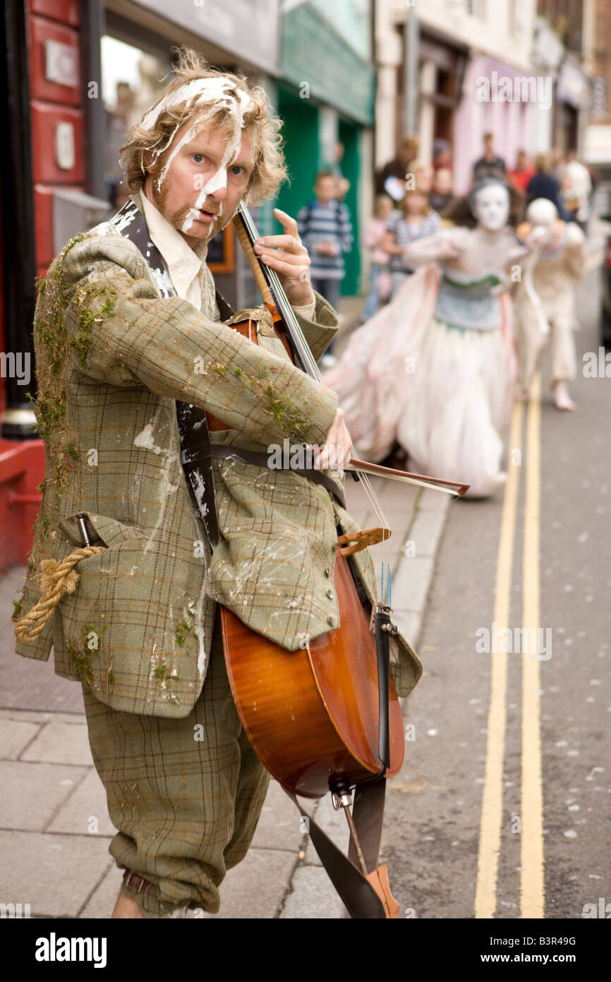 Gaelforce Arts Festival Oceanallover performing street theatre in the centre of Dumfries town centre Scotland UK - Stock Image