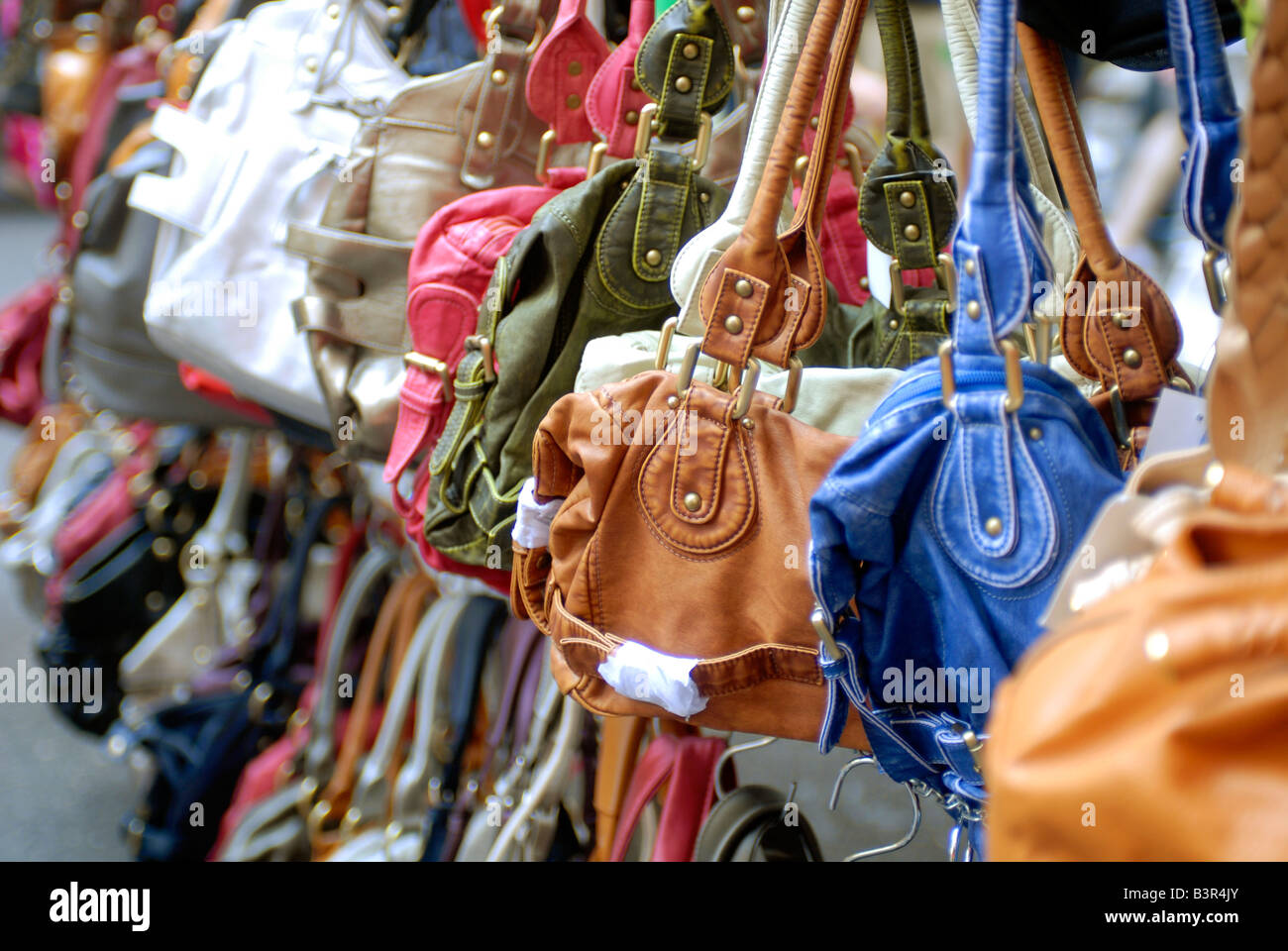 Handbags are sold at a street fair in NYC - Stock Image