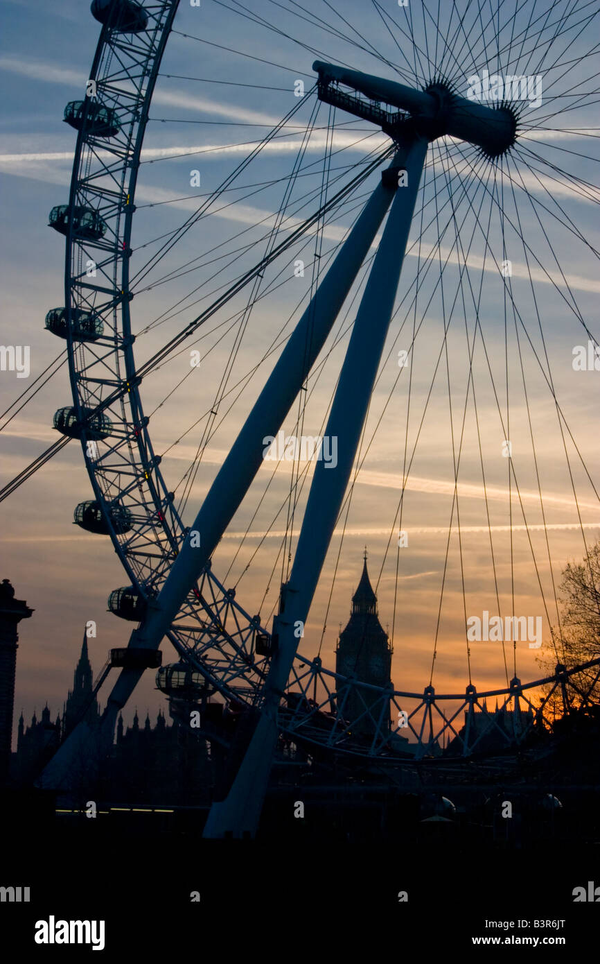 Big Ben The Houses of Parliament and the London Eye silhouetted at dusk London - Stock Image