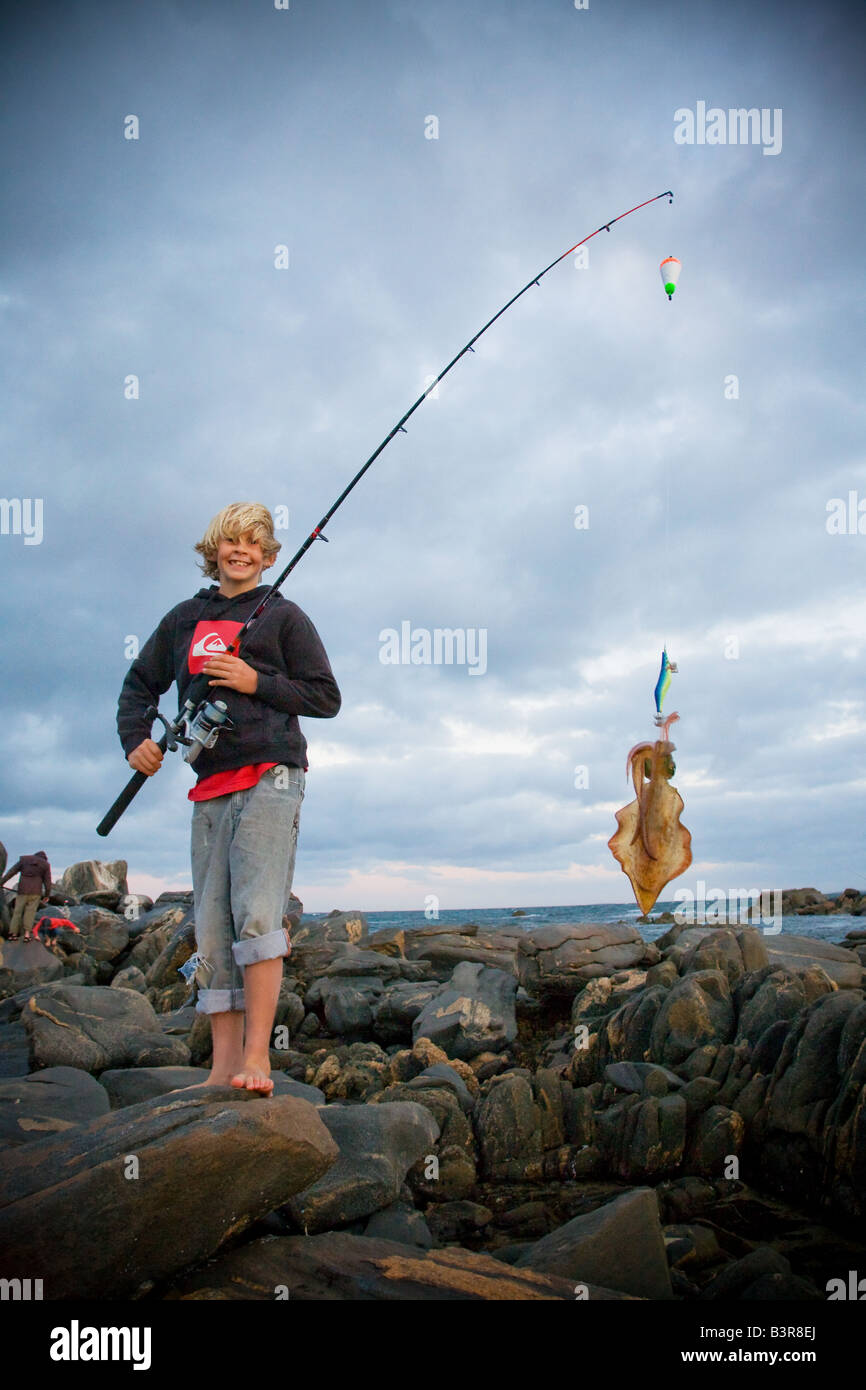 Boy with a squid - Stock Image