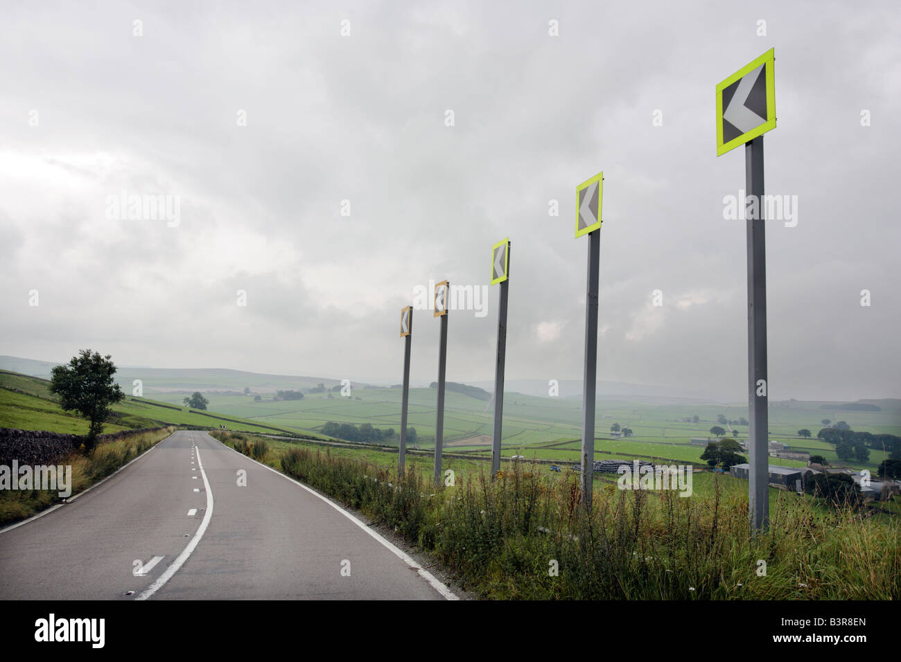 A dangerous left hand bend on the A623 near the village of Peak Forest in the Derbyshire Peak District UK - Stock Image