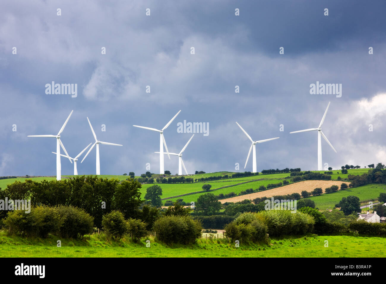 Rural wind farm with wind turbine installation in Cumbria, Lake District, England, UK - Stock Image
