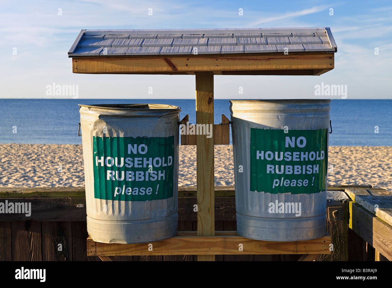 Trash cans placed along the beach to discourage littering as well as dumping Cape Cod MA USA - Stock Image