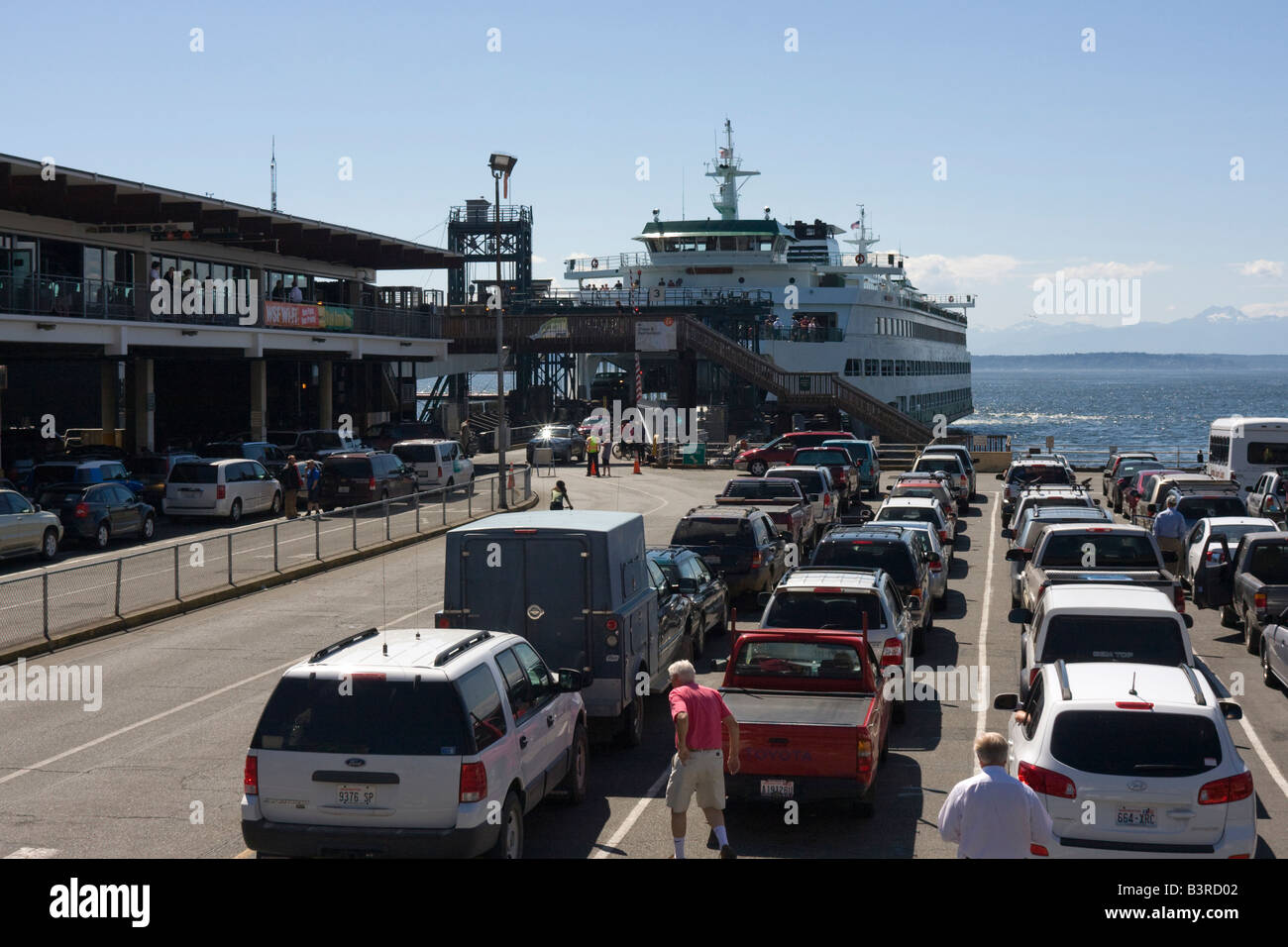 Cars waiting for Washington State ferry at Seattle Ferry Terminal Seattle WA USA full car park - Stock Image