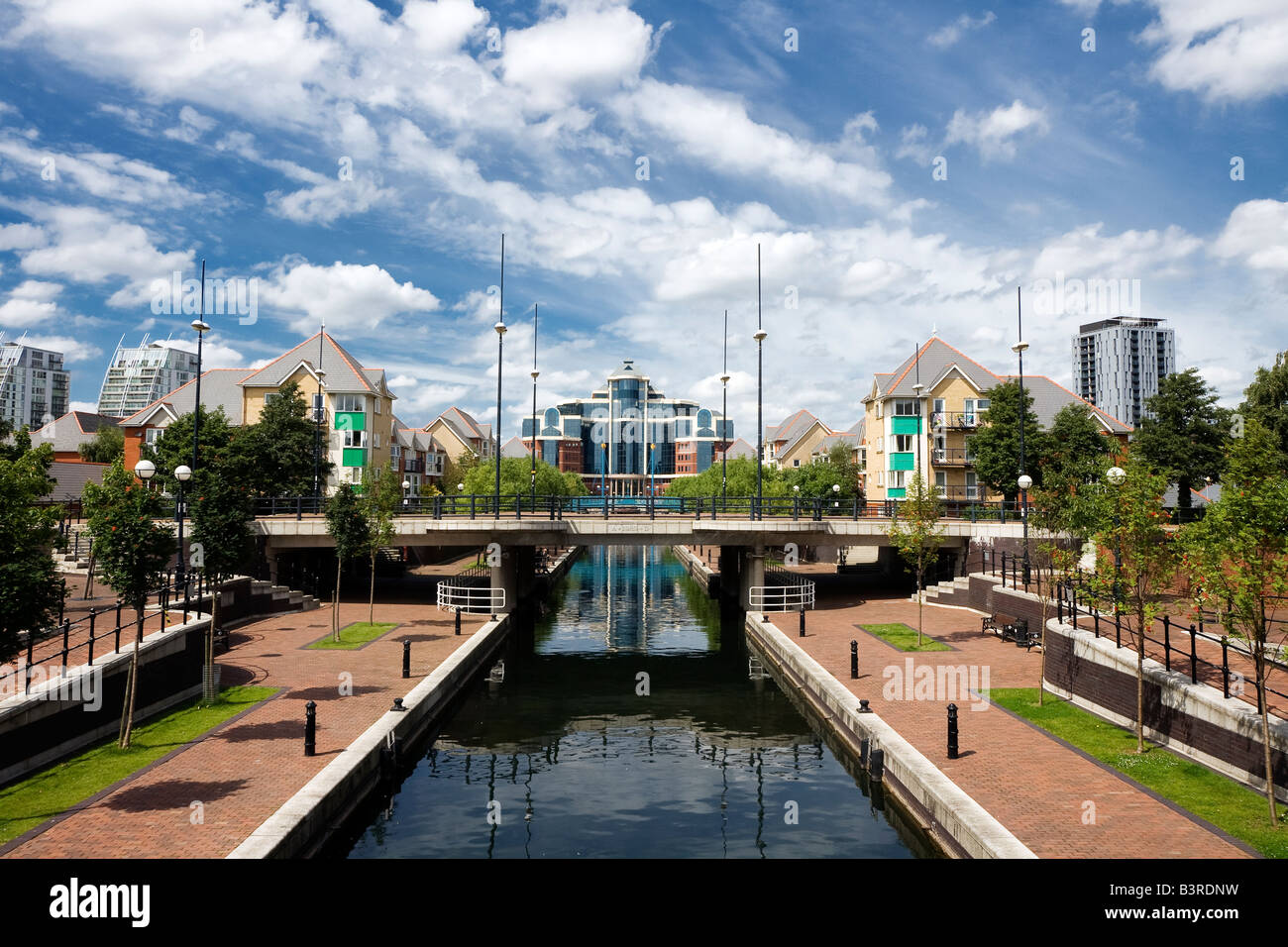 salford quays in manchester, england, looking towards Granary wharf reflecting in the water of the mariners canal - Stock Image