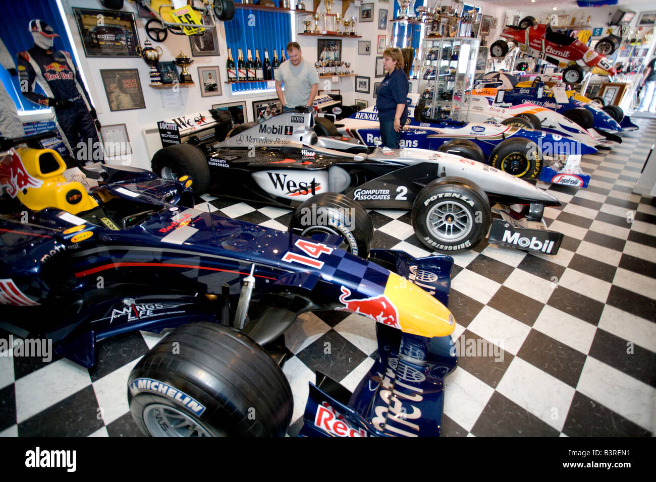 Formula One Racing Driver David Coulthard Museum Two People Looking At F1 Cars Twynholm Dumfries And Galloway Scotland UK
