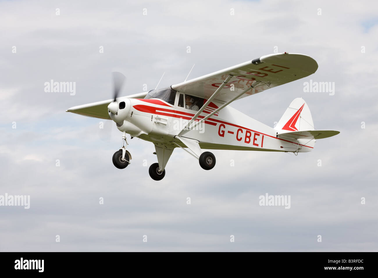 Piper PA-22-108 Colt G-CBEI in flight at Breighton Airfield Stock