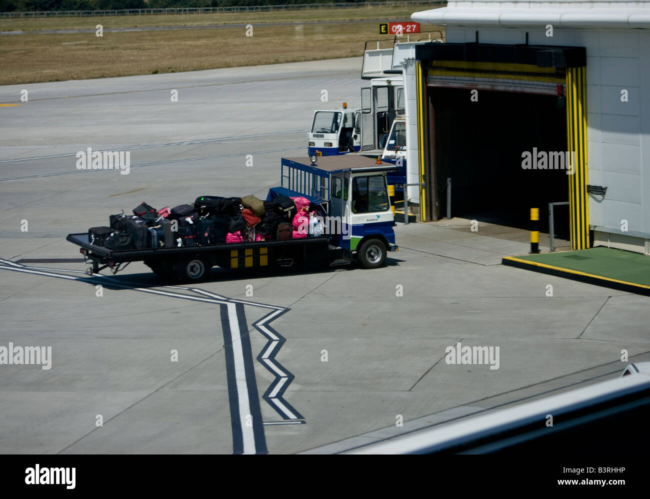 baggage Handler Jersey Airport Air side Luggage - Stock Image