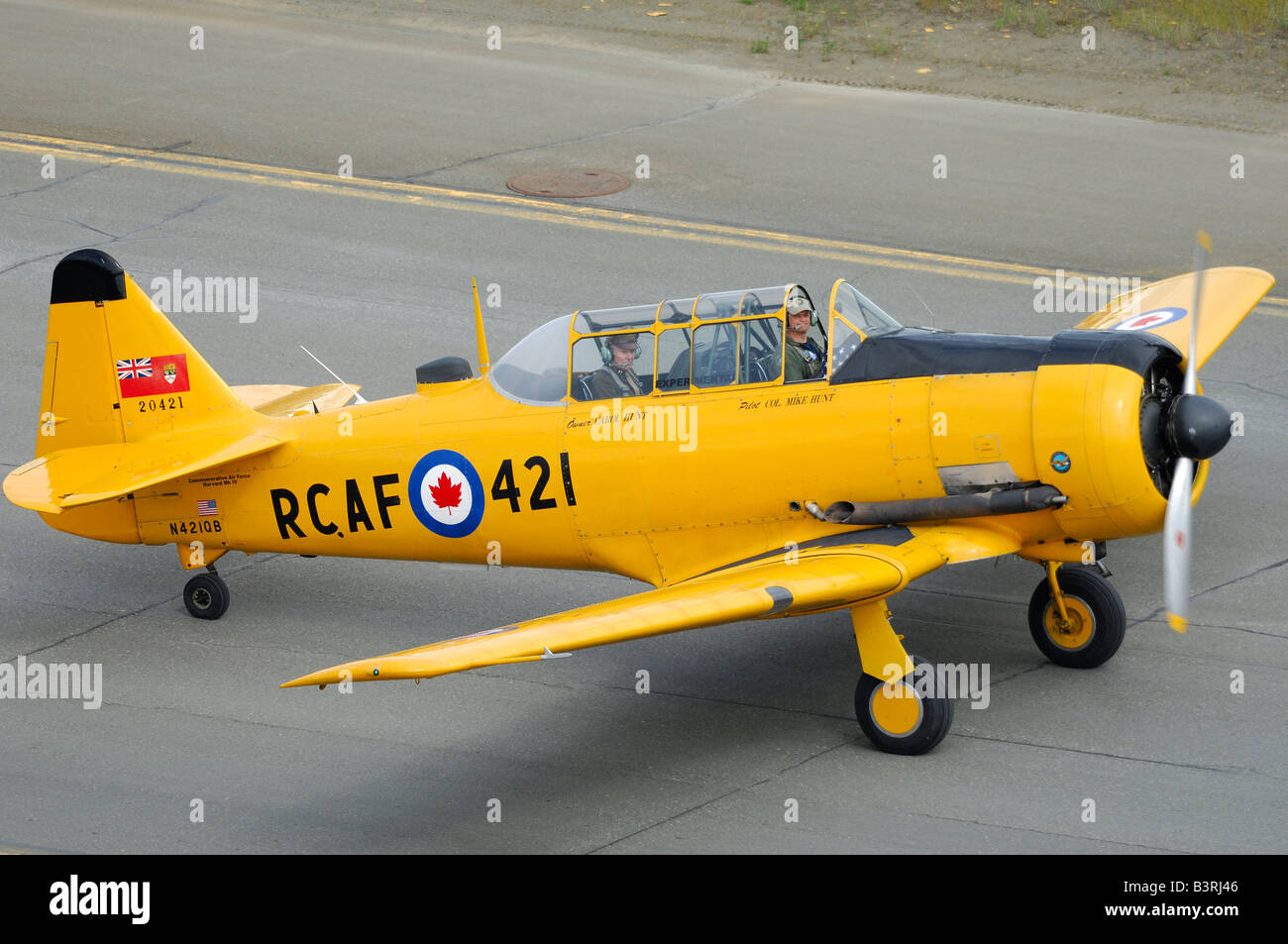Old trainer plane North American AT-6 Texan on the taxiway during an airshow in Alaska - Stock Image