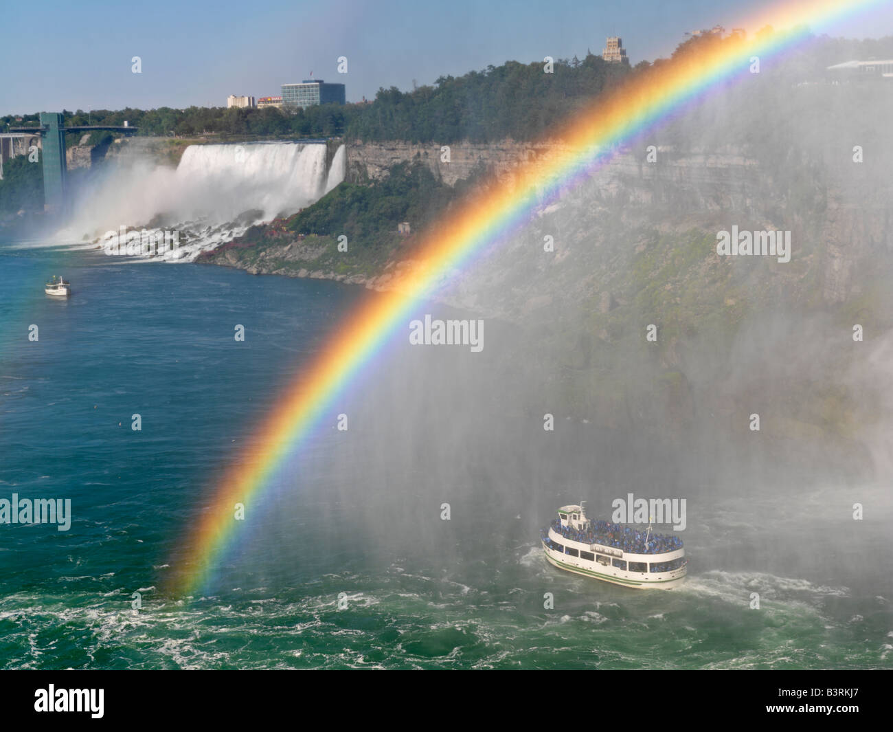 Canada,Ontario,Niagara Falls,Maid of the Mist tour boat approaching the American Falls with a rainbow - Stock Image