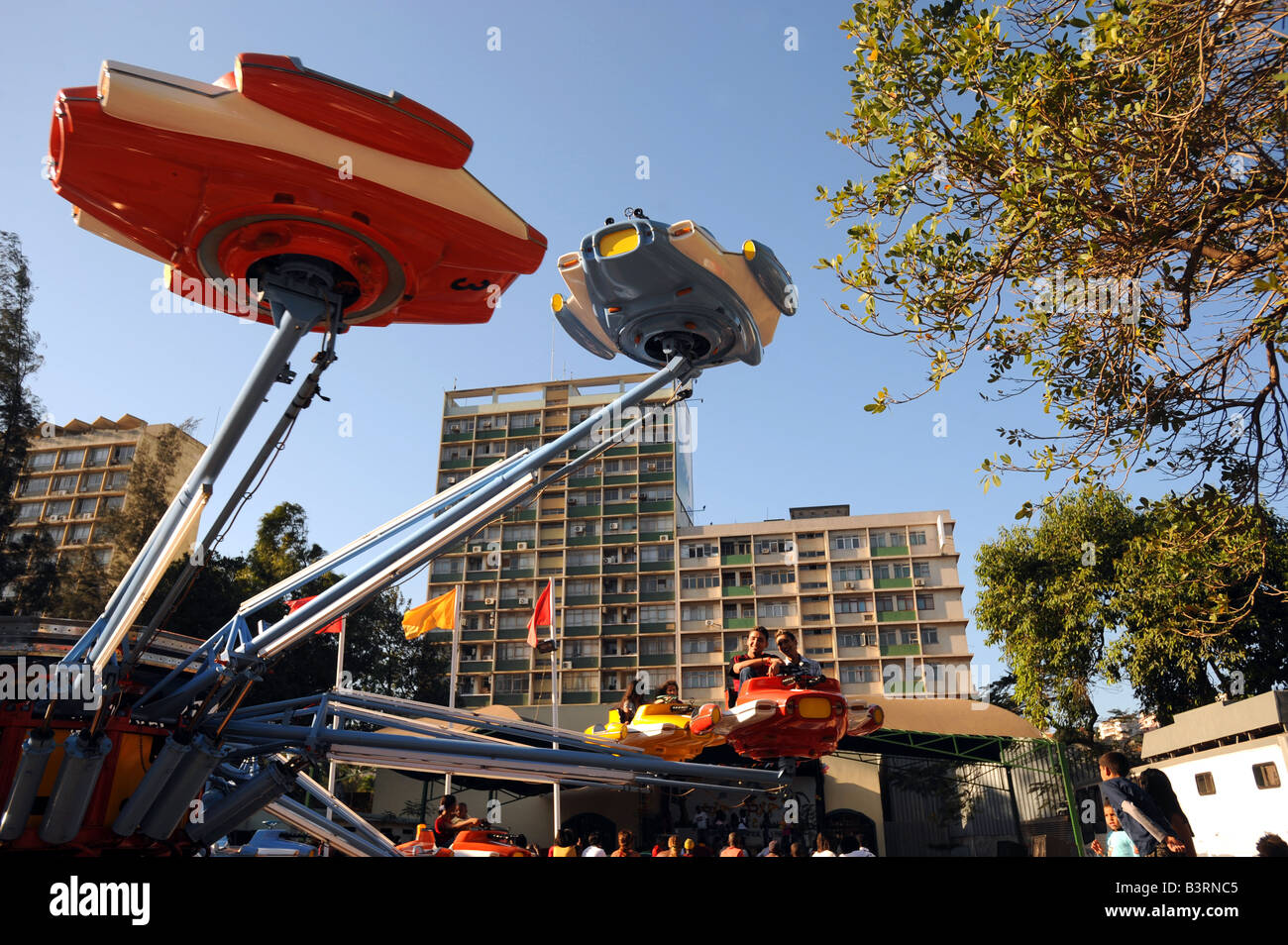 Enjoying rides on the fariground attractions at Feira Popular, Maputo, Mozambique - Stock Image