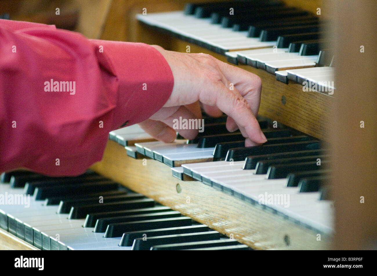 church organ organist music play playing man keys religion religious