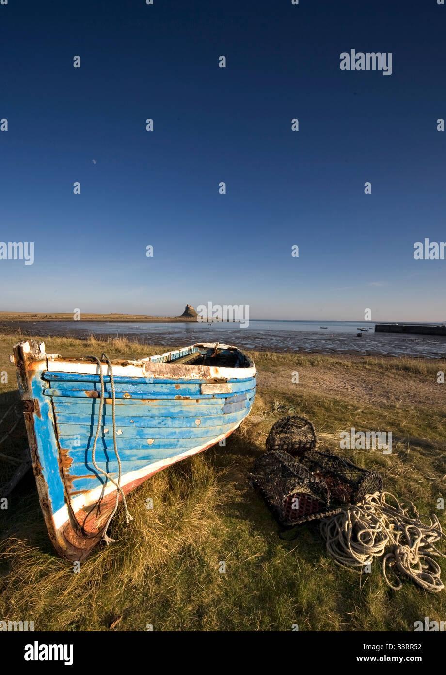 Weathered fishing boat on shore, Holy Island, Bewick, England - Stock Image