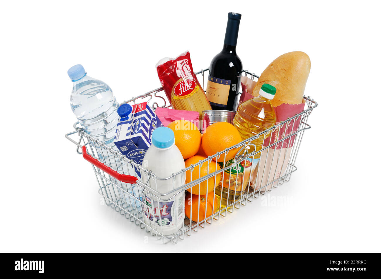 Shopping Basket Full of Groceries - Stock Image