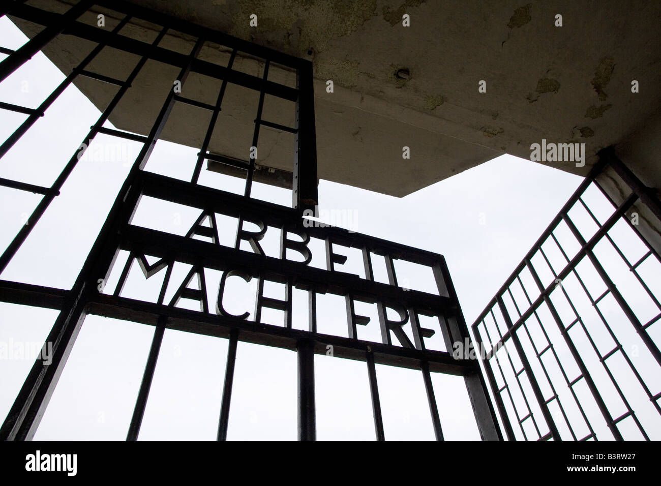 Memorial site Concentration Camp Sachsenhausen slogan Arbeit macht frei at the entrance of the concentration camp - Stock Image