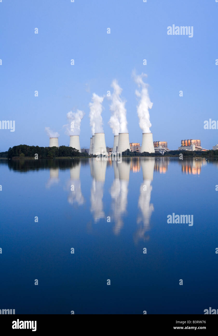 Brown coal power plant Jaenschwalde, one of the worlds power plants with the highest emission during sunset Stock Photo