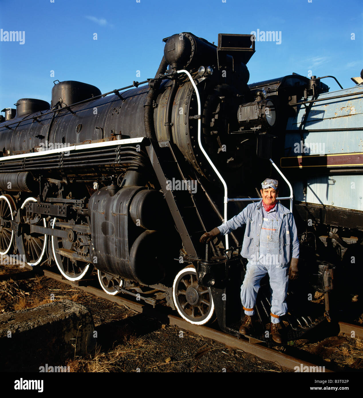 Engineer poses with old locomotive, Steamtown National Historic Site - Stock Image