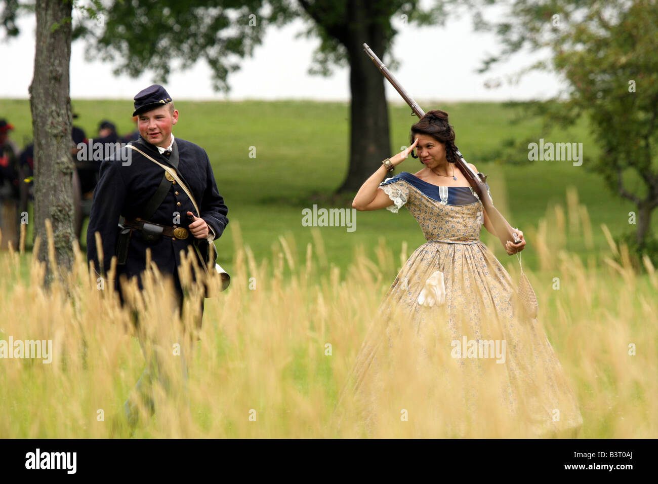 A young women flirtingly saluting a union soldier at a Civil War Encampment Reenactment Stock Photo
