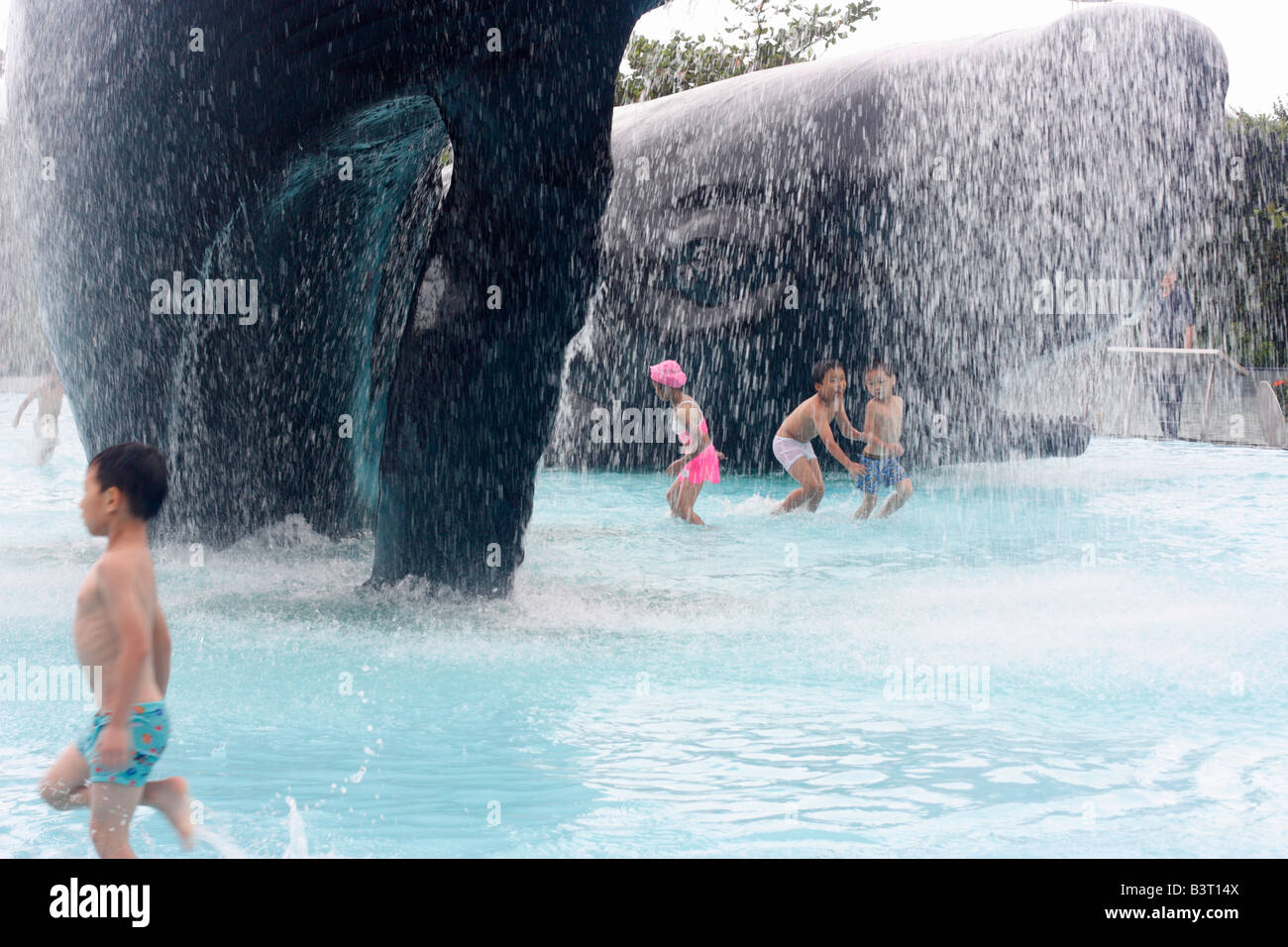 Wading pool with life-sized whale sculptures. National Museum of Marine Biology and Aquarium, Taiwan - Stock Image