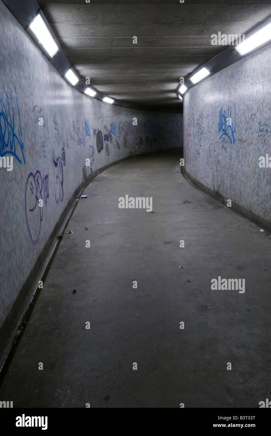 Subway in Belfast at night, showing grafitti - Stock Image