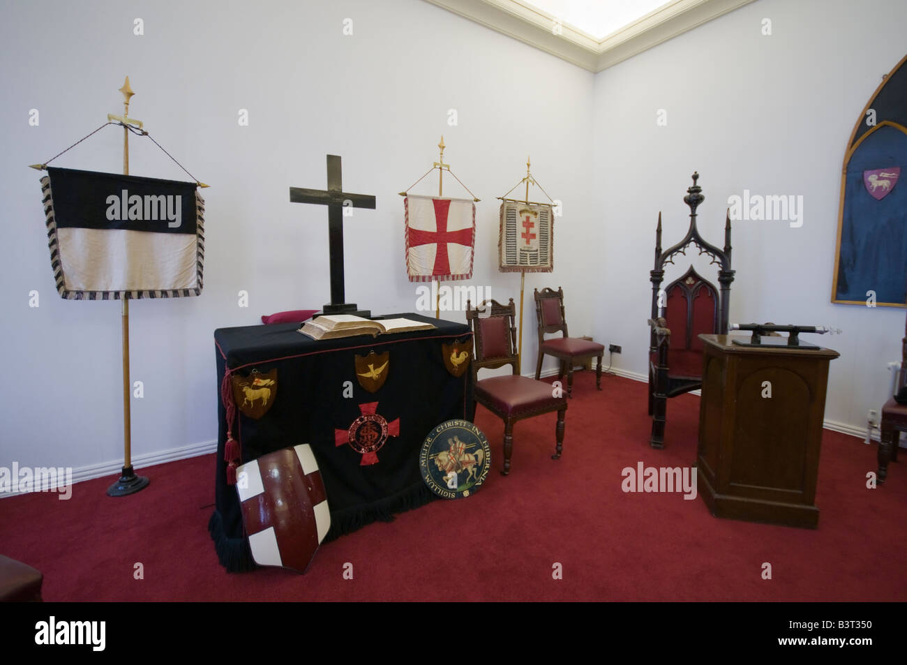Knights Templar banners at the Grand Master's position in a Masonic Hall. - Stock Image