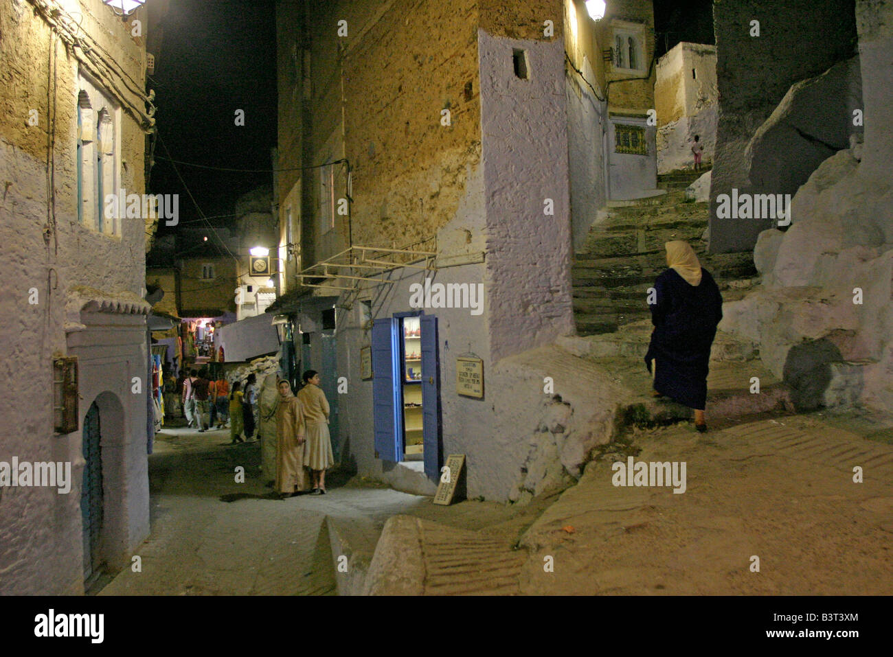 The streets of Chefchaouen at night. After the heat of the day the streets are busy until late. - Stock Image