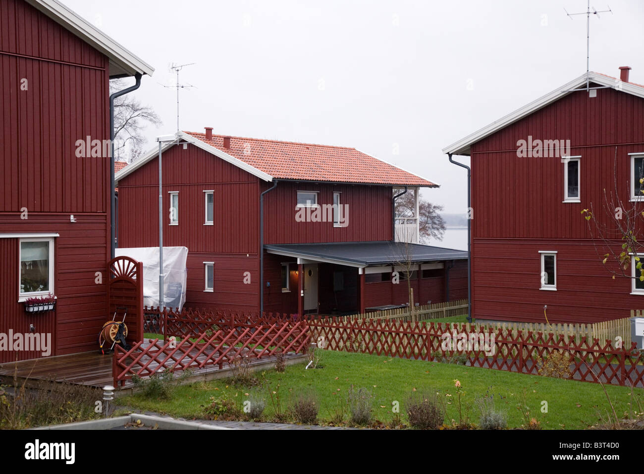 Red modern houses close together in a suburb - Stock Image