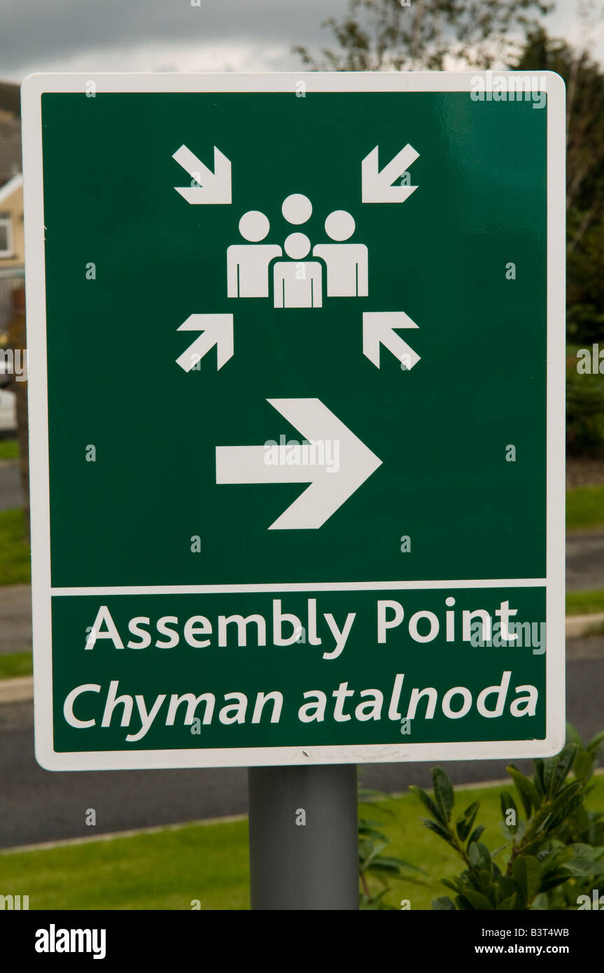 Bilingual welsh and english sign for fire and emergency assembly point the welsh is incorrect meaningless computer - Stock Image
