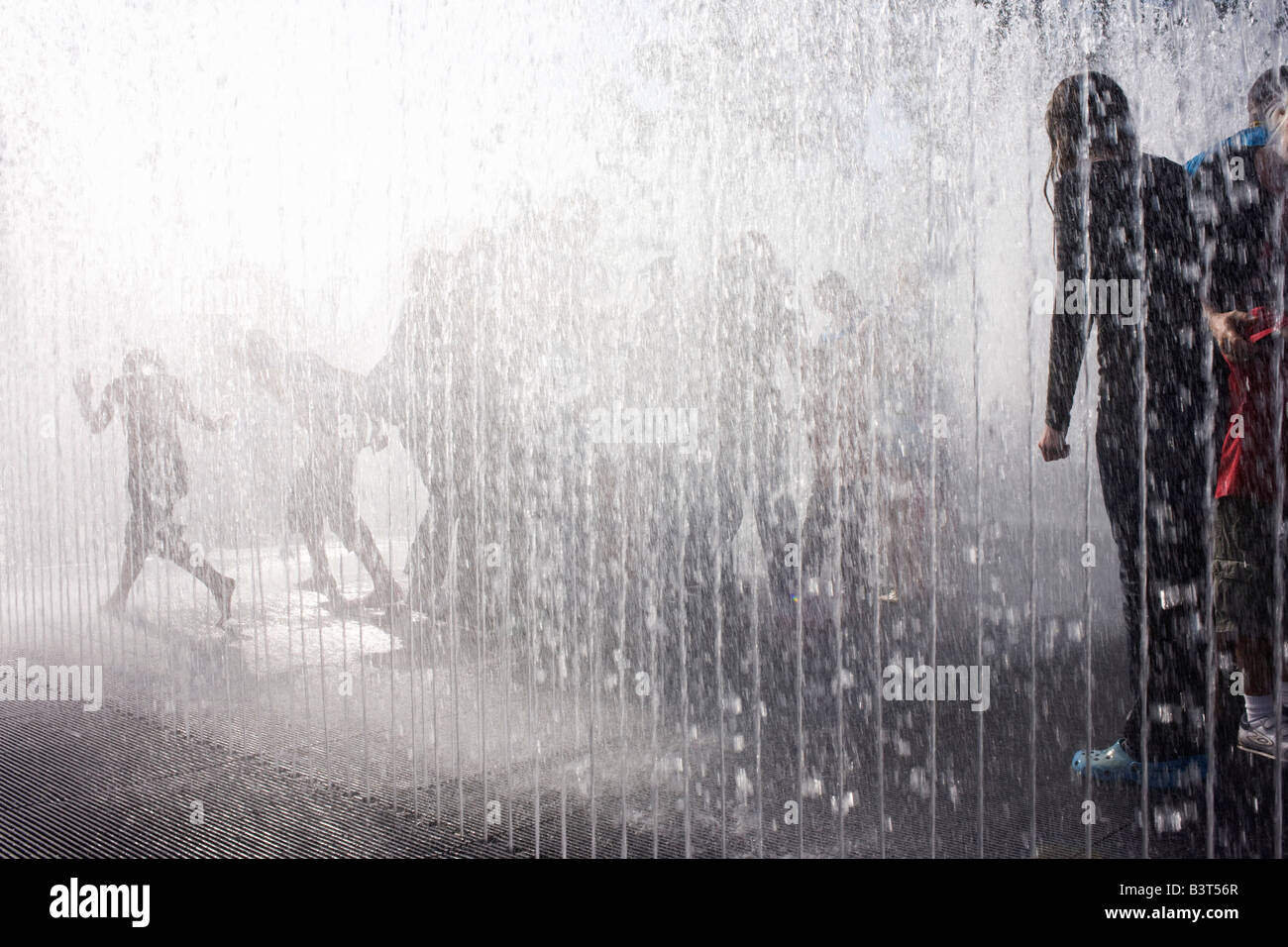 Londoners get wet in automated fountains at the Southbank during the Mayor's free Thames Festival celebration - Stock Image