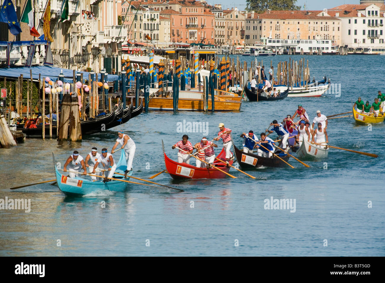 Teams race along the Grand Canal in Venice for the Historical Regatta which takes place each September - Stock Image