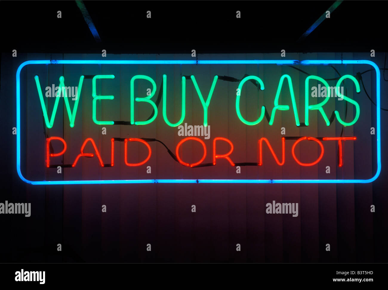 neon sign we buy cars paid or not Stock Photo: 19585593 - Alamy
