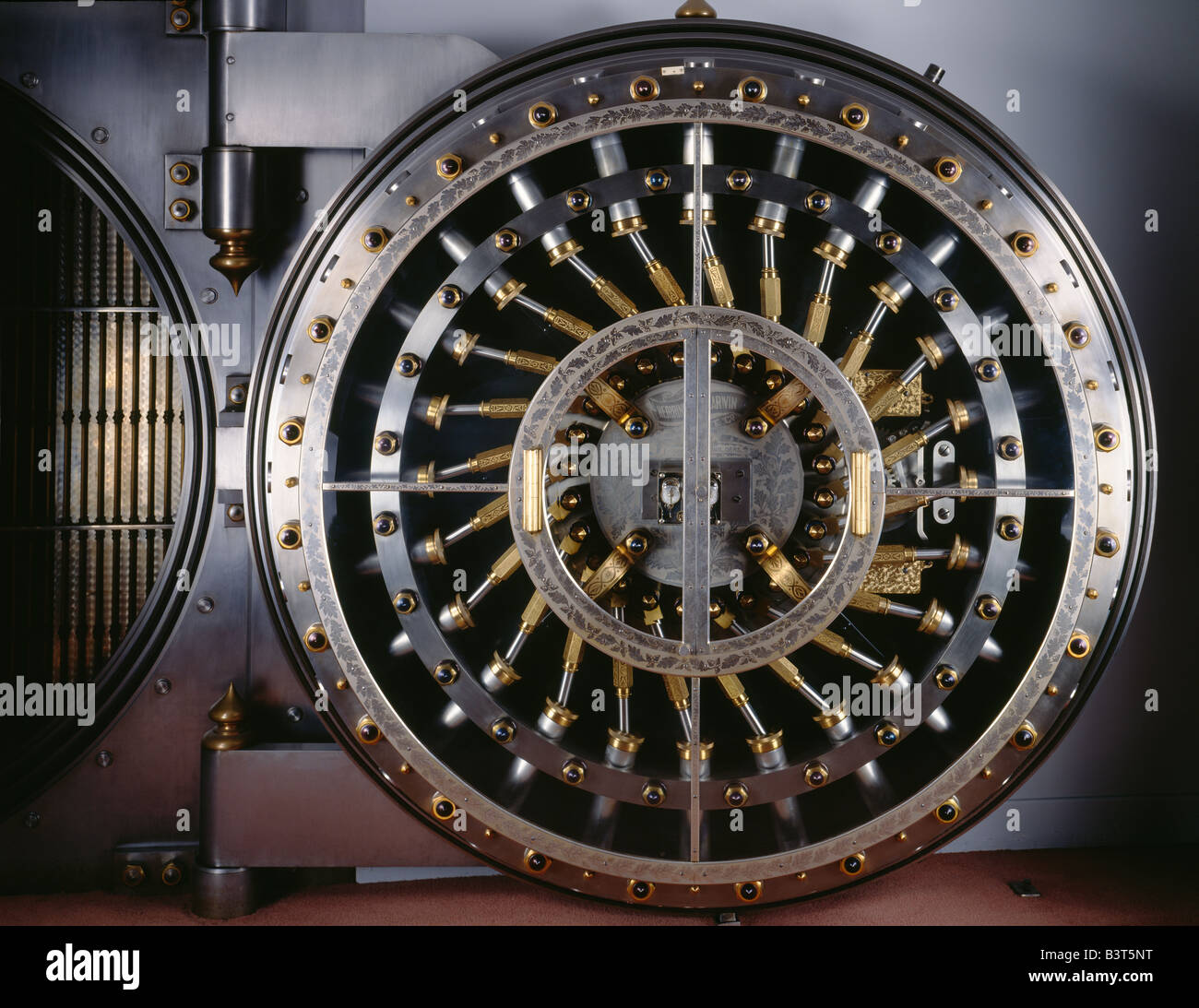 Bank vault door, featuring the stainless steel and brass locking mechanism. - Stock Image